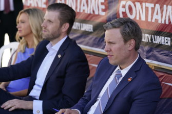 Donald Trump's 2020 presidential campaign manager Bill Stepien (right), with White House press secretary Kayleigh McEnany, and Eric Trump, son of President Donald Trump, during a campaign event in August.