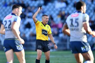 Referee Matt Cecchin signals six-again during a Storm-Warriors clash earlier this season.