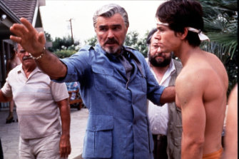 Burt Reynolds and Mark Wahlberg on the set of Boogie Nights.