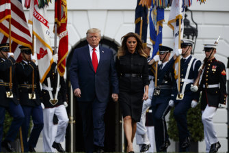 President Donald Trump and first lady Melania Trump arrive for a moment of silence at the White House.