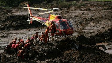 Firefighters are resupplied as they search for victims of the Vale dam collapse in Brumadinho.