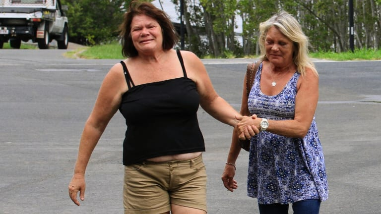 Sandra Roome (left) and Christine Landy comfort each other as the family waits for news.