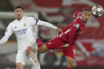 Liverpool's Thiago, right, is challenged by Real Madrid's Federico Valverde.