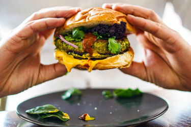 Green lentil, feta, chickpea and spice bomb burger with turmeric and harissa yoghurt.