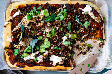 Lamb, maple, sumac and pistachio 'pizza' recipe with tahini yoghurt and charred onions.