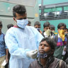 India's daily coronavirus cases soar past 100,000 for the first time