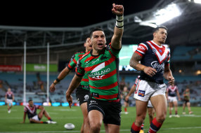 Rabbitohs five-eighth Cody Walker celebrates scoring a try against the Roosters on Friday night.