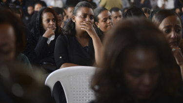 Mourners attend the memorial service for the Ethiopian Airlines air crew.