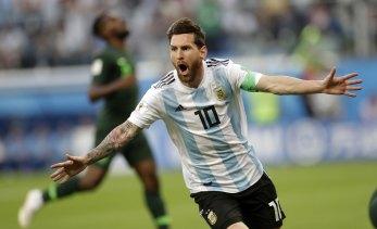 Lionel Messi scores for Argentina against Nigeria.