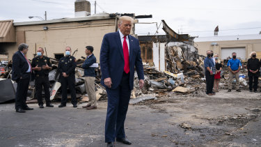 US President Donald Trump tours an area damaged during demonstrations after a police officer shot Jacob Blake in Kenosha, Wisconsin.