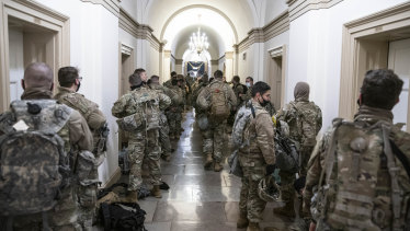 Members of the National Guard assemble in a hallway of the US Capitol building in Washington.