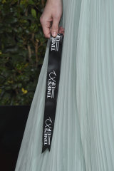 Australian actress Yvonne Strahovski carries a Time's Up ribbon on the red carpet.