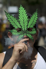A young man smokes marijuana to celebrate the International Day for Cannabis in Mexico City.