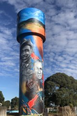 Captain Reg Saunders (left) on the water tower in Heywood, south-west Victoria.