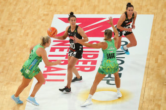 Ash Brazill, centre, looks to pass the ball during round six.