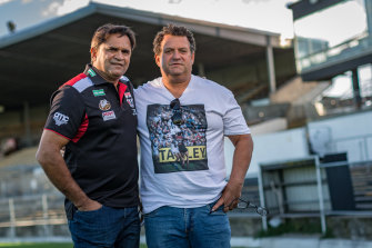 Saints great Nicky Winmar and photographer Wayne Ludbey at Victoria Park in 2018.