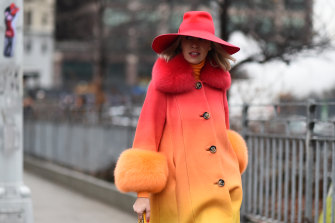 Denisa Palsha is pictured in New York wearing a coat by Saks Potts. The brand is bucking a trend by continuing its use of fur.