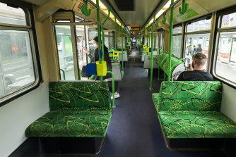 A near-empty tram travels along St Kilda Road.