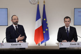 French Prime Minister Edouard Philippe, left, speaks with French Minister for Solidarity and Health Olivier Veran.