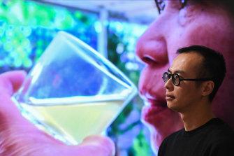 Artist James Nguyen at Montsalvat Gallery with his prize-winning digital artwork.