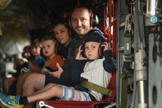 Tim Buckley and son Jackson on board a Chinook helicopter with their family Meaghan Wegg and Georgia.