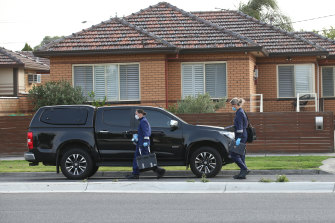 Forensic police work at the scene of the fatal shooting on Friday morning.