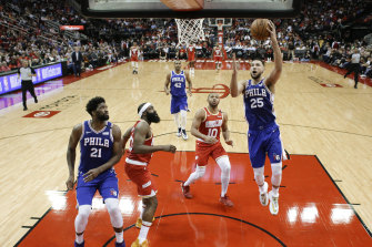 High flyer: Ben Simmons, right, scored a triple-double against Houston Rockets.