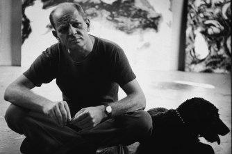 Jackson Pollock in his studio with his dog in 1953, the year after he painted 'Blue Poles'.