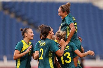 The Matildas celebrate one of Sam Kerr's two goals against Sweden.
