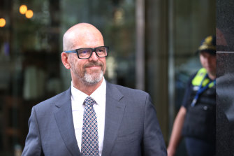 Former Victoria Police chief commissioner Simon Overland leaving the royal commission in December.
