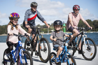 David Burton with Finn 18, Mia 8, Max 5, in Drummoyne getting ready for Spring Cycle 2019.