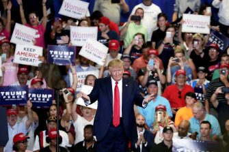 US President Donald Trump acknowledges the crowd as he speaks at a campaign rally in Fayetteville, North Carolina, on Monday.