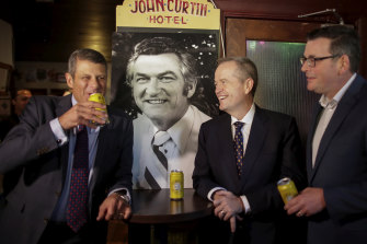 Former Victorian premier Steve Bracks, then opposition leader Bill Shorten and Victorian Premier Dan Andrews drink to the memory of Bob Hawke at Melbourne's John Curtin Hotel in 2019.  Hawke made Melbourne his political base, but the economic reforms he and Paul Keating enacted meant federal governments could be elected without Melbourne's votes.