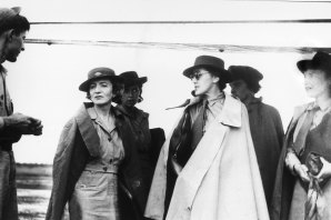 Herald journalist Connie Roberts in sunglasses and white coat during World War II.