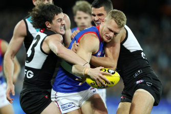 Dogs claim Power scalp, Tigers snatch win from jaws of defeat