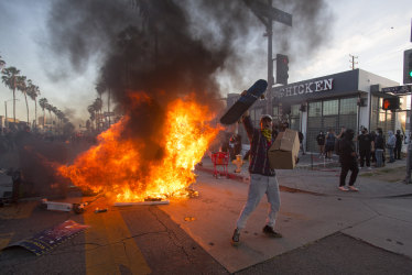 Clashes, looting and buildings torched: protesters defy curfews in dozens of cities