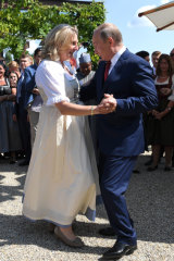 Russian President Vladimir Putin dances with Austrian Foreign Minister Karin Kneissl at her wedding in Gamlitz, southern Austria, in August of last year.