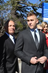 Callan Sinclair, right, leaves Wollongong Local Court last month.