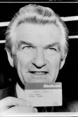 Bob Hawke holds one of the first Medicare cards issued.