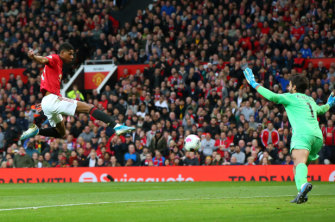 Marcus Rashford scores the opener for Manchester United.
