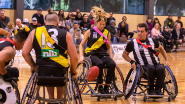 Richmond's Yasmina McGlone and Collingwood captain Brendan Stroud battling it out.