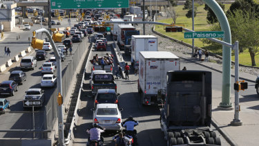 Cars and trucks line up to enter Mexico from the US at a border crossing in El Paso, Texas, on Friday, March 29.