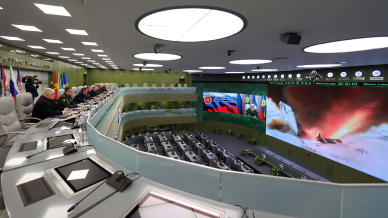 Top officials oversee the test launch of the Avangard hypersonic glide vehicle from the Defence Ministry's control room in Moscow.