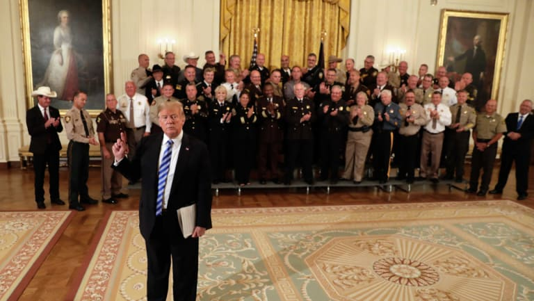 US President Donald Trump speaks to members of the media during a meeting with sheriffs from across the country at the White House.