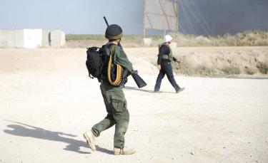 Israeli snipers walk at the Gaza border.