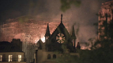 Flames and smoke rise from a fire at Notre-Dame Cathedral.