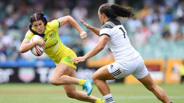 Speedy: Charlotte Caslick on the fly against New Zealand during the Sydney Sevens.