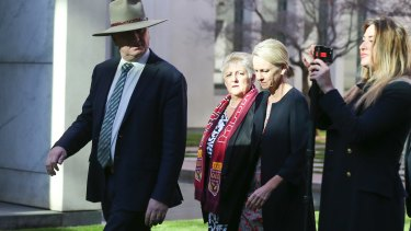 Deputy Prime Minister and Minister for Infrastructure and Transport Barnaby Joyce (left) and his media adviser Vikki Campion (right) seen arriving for a press conference last June.