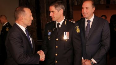 Roman Quaedvlieg at his Border Force swearing-in ceremony with then immigration minister Peter Dutton and prime minister Tony Abbott.