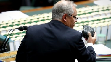 Federal Treasurer Scott Morrison shows off a lump of black coal during question time last year.